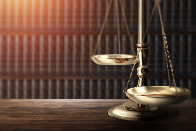 judge s gavel wooden background top view 99433 287 Hernandez y Mora Abogados
